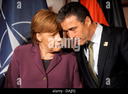 NATO General Secretary Anders Fogh Rasmussen (r) talks with German Chancellor Angela Merkel during a reception at - Stock Photo