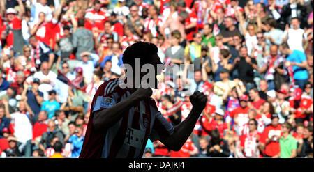 Munich's Mario Gomez cheers after his 2-0 goal during a German Bundesliga match of FC Bayern Munich versus Bayer - Stock Photo