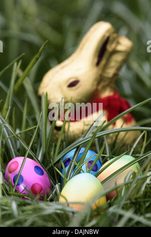 (dpa-file)- A file picture dated 08 April 2009 shows colourful Easter eggs and a chocolate Easter bunny lying in - Stock Photo