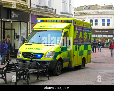 Sussex Ambulance Service Paramedic Unit attending an emergency in Worthing town centre shopping area West Sussex - Stock Photo