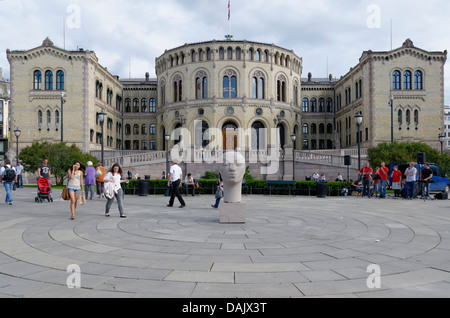 Space with a sculpture in front of the Storting, Parliament of Norway Building - Stock Photo