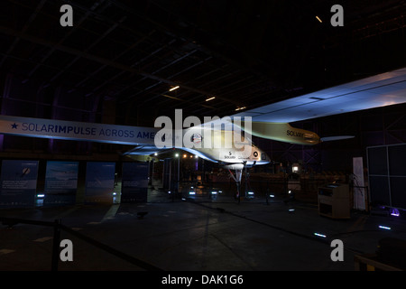 NEW YORK - JULY 13: Solar Impulse plane on display at hangar in John F.Kennedy airport on July 13, 2013 in New York - Stock Photo