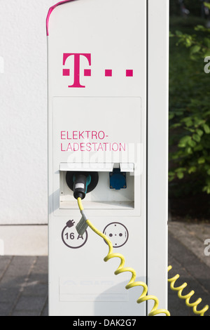 Electric car charging station at Deutsche Telekom headquarters in Bonn, 12.07.2013. - Stock Photo