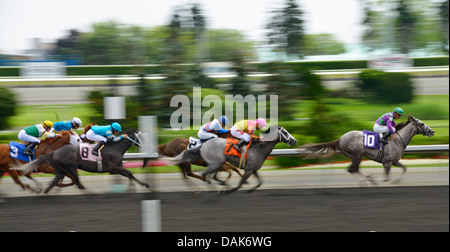 Victory Exchange leading the field in race 5 of the Queens Plate at Woodbine Racetrack Toronto Canada - Stock Photo