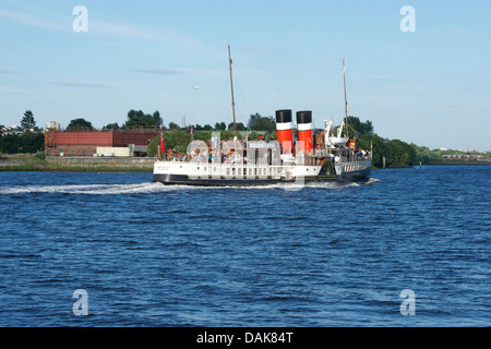 Paddle steamer cruising up the Clyde towards Glasgow at Erskine. - Stock Photo