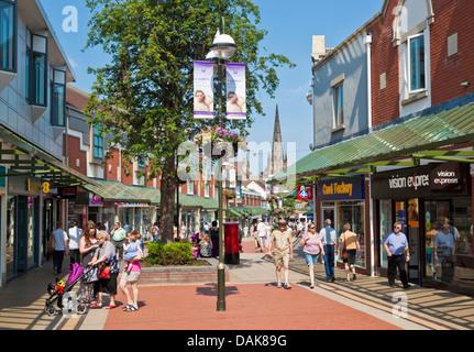 People shopping in shops on Baker's lane shopping street pedestrianised precinct Lichfield Staffordshire England - Stock Photo