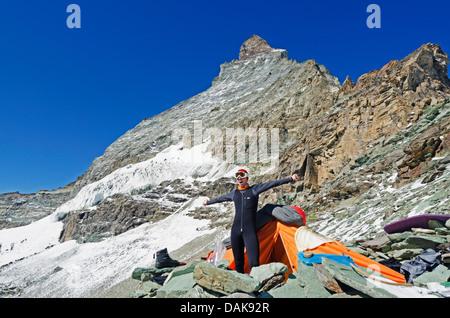 climber camping on The Matterhorn (4478m), Zermatt, Swiss Alps, Switzerland, Europe (MR) - Stock Photo
