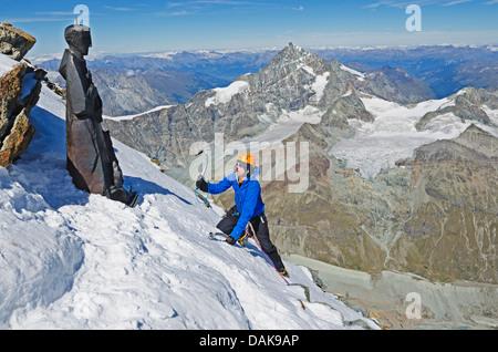 climber on The Matterhorn (4478m), Zermatt, Swiss Alps, Switzerland, Europe (MR) - Stock Photo