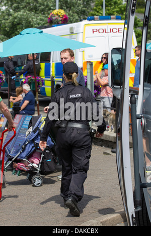 Police security female officers checking for bombs - explosives before royal visit to Bowness on Windermere - Stock Photo
