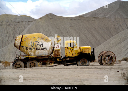Anti-Hilary Rodham Clinton sentiments are spray painted on an ancient cement truck in a southern Utah quarry. - Stock Photo