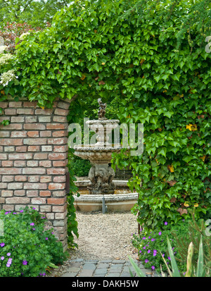 English ivy, common ivy (Hedera helix), ivy-covered garten gate, Netherlands - Stock Photo