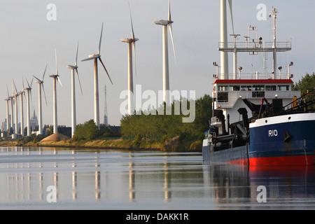 wind wheels along a canal, Belgium, Zeebrugge - Stock Photo