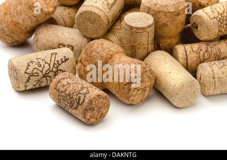 Close up of used assorted wine corks on white - Stock Photo