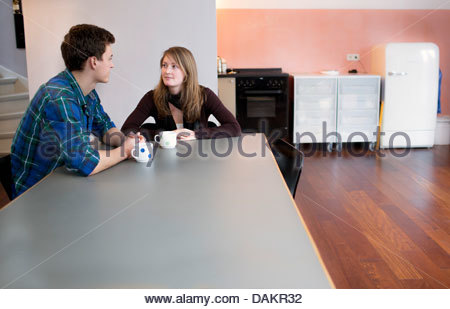 Young couple having coffee - Stock Photo