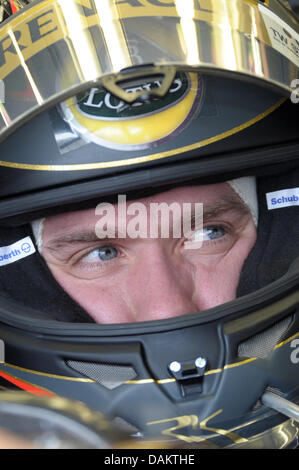 German Formula One driver Nick Heidfeld of Lotus Renault sits in his car during the second practice session at the - Stock Photo