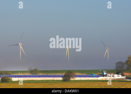 ship on river Waal with windmills, Netherlands, South Holland - Stock Photo