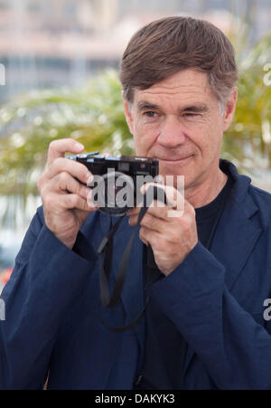Director Gus Van Sant attends the photocall for the film  'Restless' at the 64th Cannes International Film Festival - Stock Photo