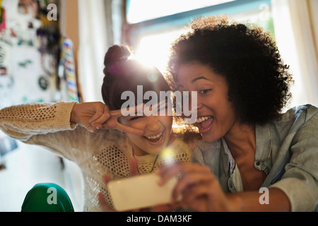 Women taking picture together - Stock Photo