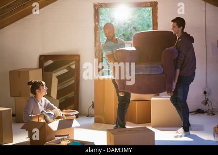 Friends moving furniture in new home - Stock Photo
