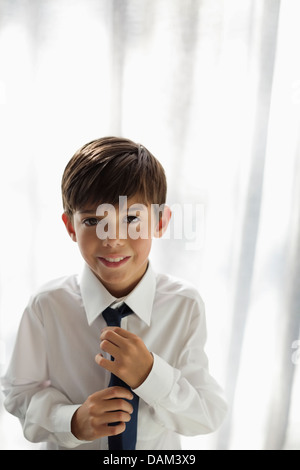 Smiling boy wearing shirt and tie - Stock Photo
