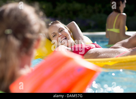 Mother and daughter in swimming pool - Stock Photo