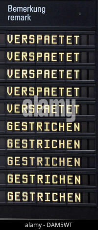 A destination board informs passengers on cancelled and delayed flights at the airport in Bremen, Germany, 25 May - Stock Photo