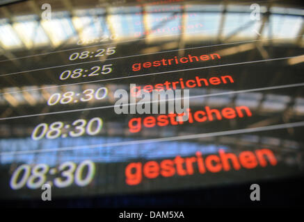 A destination board informs passengers on cancelled flights at the airport in Hamburg, Germany, 25 May 2011. An - Stock Photo