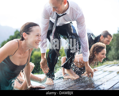 Fully Dressed Woman Climbing Out Of Swimming Pool Stock Photo Royalty Free Image 58224805 Alamy