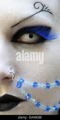 (dpa File) An archive picture, dated 29 May 2009, shows a make-up covered face of a female festival visitor of the - Stock Photo