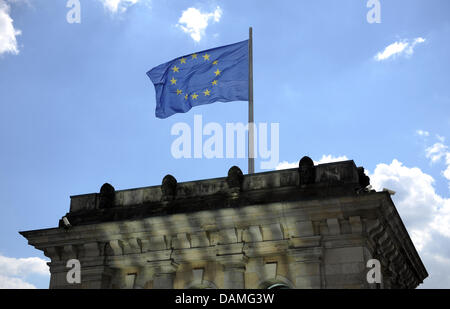An European flag has been set up on the roof of the Reichstag in Berlin, Germany, 25 May 2011. The President of - Stock Photo