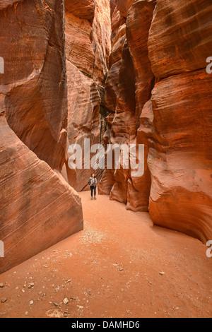 Hiker in the Buckskin Gulch slot canyon, Kanab, Utah - Stock Photo