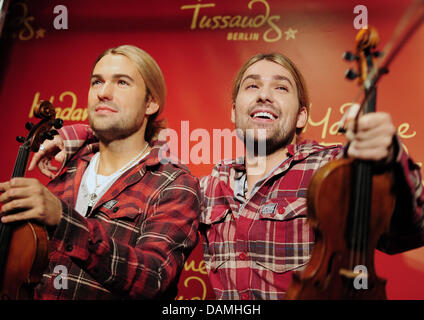 Star violinist David Garrett (R) unveils a wax figure of himself at 'Madame Tussauds' in Berlin, Germany, 16 June - Stock Photo