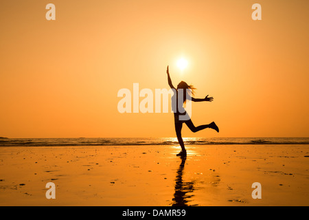 abstract silhouette of happy young jumping girl, healthy life - Stock Photo