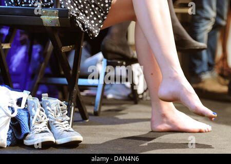 A models seen waiting backstage for her  show during the Mercedes-Benz Fashion Week in Berlin, Germany, 07 July - Stock Photo