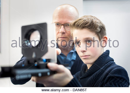 Student with a teacher using optical table in a lab - Stock Photo