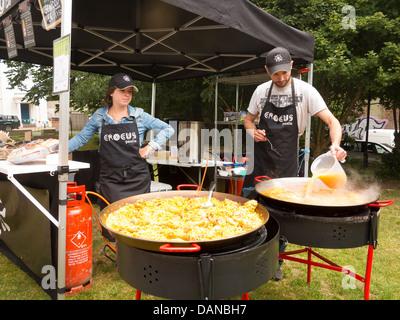Paella pans in street food market in Brighton - Stock Photo
