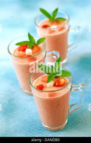 Watermelon smoothie with strawberries and coconut. Recipe available. - Stock Photo