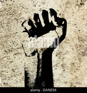 Retro style clenched fist held high in protest against grunge concrete wall background indicating revolution or - Stock Photo