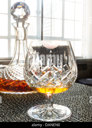 Crystal Decanter and Brandy Snifter Still Life - Stock Photo