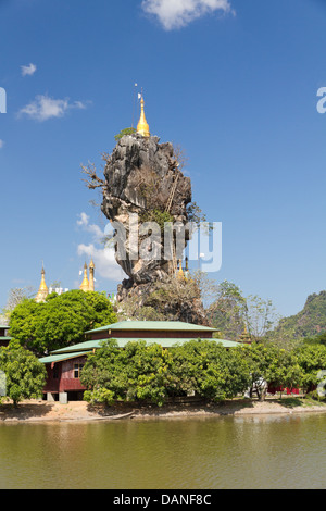 rock pinacle with golden stupa on temple island, Hpa An, Burma - Stock Photo