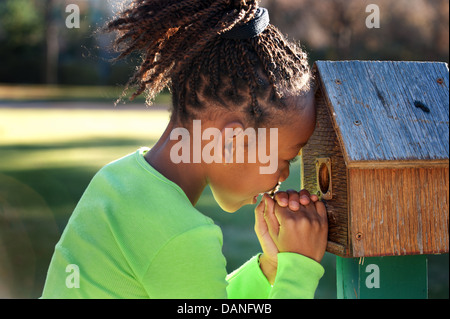 Young African American girl playing in a park. - Stock Photo