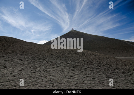 A group of hikers on the slopes of Mount Etna on a clear day - Stock Photo