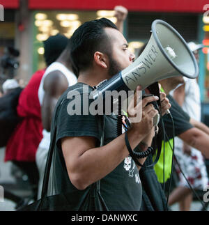 Los Angeles, California, USA. 16th July, 2013. Protesters march through downtown Los Angeles to speak out against - Stock Photo