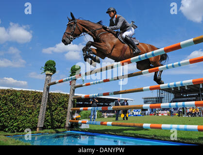 German equestrian Marco Kutscher jumps with his horse Cash during the CHIO show jumping for the North Rhine-Westphalia - Stock Photo