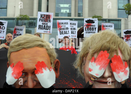 Dressed as Foreign minister Westerwelle (L) and Chancellor Merkel (R) activists of the organisation Campact demonstrate - Stock Photo