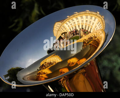 The Schleissheim Palace is reflected in an instrument of a musician during the summer reception of the Bavarian - Stock Photo