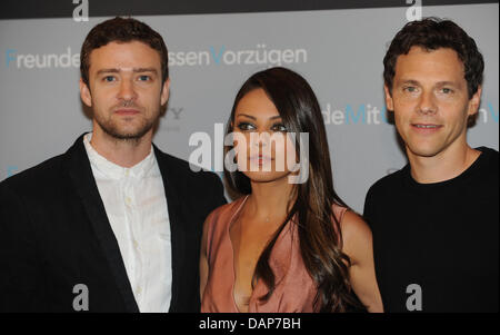 Actors Justin Timberlake (L-R) and Mila Kunis and director  Will Gluck pose during the presentation of their movie - Stock Photo