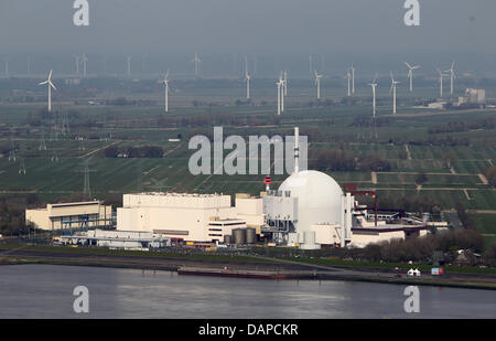 FILE - An archive picture dated 24 April 2010 shows the nuclear power plant Brokdorf in front of wind wheels in - Stock Photo