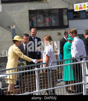Windermere, UK. 17th July 2013.  Her Majesty the Queen & The Princess Royal  ( in Yelow a visit to Lake Windermere - Stock Photo