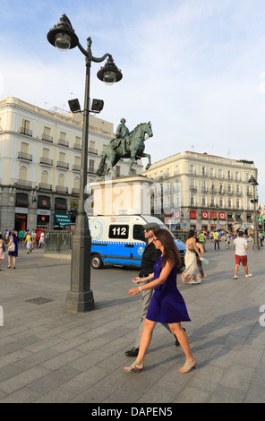 Pedestrians in Puerta del Sol, central Madrid - Stock Photo